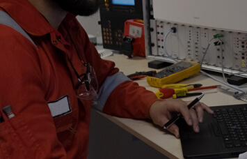 workman using fire detection equipment