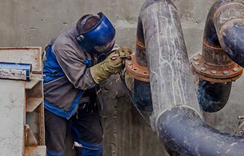 engineer installing pipeline