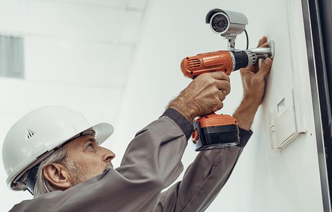 workman installing cctv system